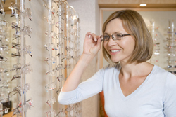 older-woman-trying-on-glasses-eye-doctor-optometry